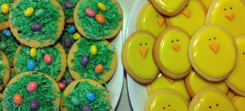Photo of Sugar Cookies decorated like chicks and Easter grass with jelly beans